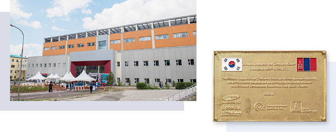 The completed second hospital building of the National Medical Center of Mongolia and its commemorative plaque.